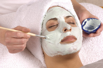 spa esthetician applying facial masque