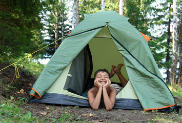 happy boy in camping tent