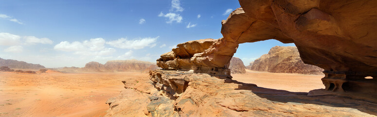 natural bridge and panoramic view of Wadi Rum desert, Jordan