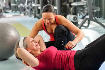 Senior woman exercise abdominal in fitness center