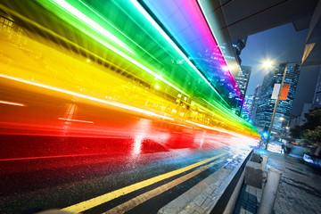 Rainbow spectrum blurred motion city bus at night