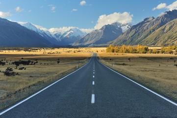 Straight empty highway leading into Aoraki-Mount Cook