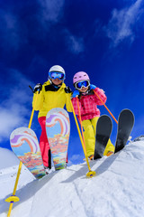 Ski and fun - skiers enjoying ski holiday