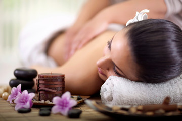Beautiful woman having a wellness back massage