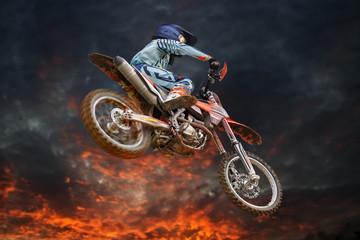 Flying motocross rider fire storm