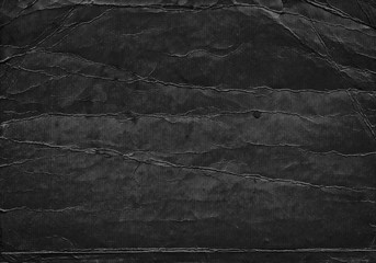 Black grunge background from old paper texture