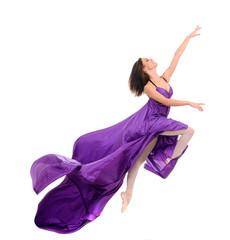 jumping girl dancer in flying purple dress