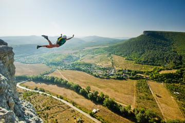 base-jumper jumps from the cliff