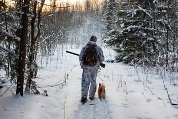 hunter comes out of the winter forest