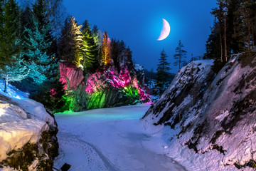 Evening lights in the marble quarry Ruskeala in Karelia in the w