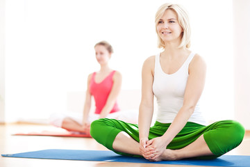 Two yogas woman indoors