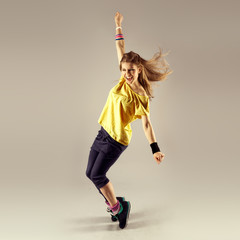 Zumba dance workout. Young sporty woman dancer in motion.