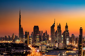 A beautiful Skyline view of Dubai, UAE as seen from Dubai Frame at sunset showing Burj Khalifa, Emirates Towers, Index Building and DIFC