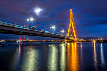 Cable stayed bridge over Martwa Wisla river at night in Gdansk. Poland Europe.