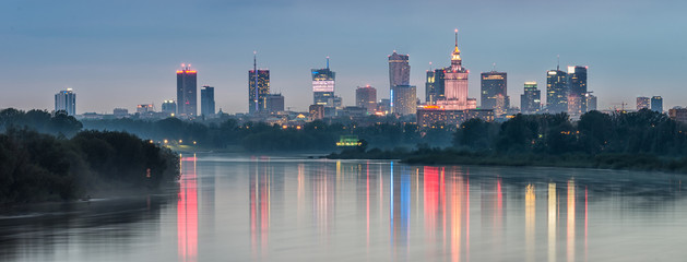 Night panorama of Warsaw skyline, Poland, over Vistula river in the night