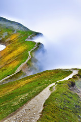 Beautiful view of path in foggy Tatra mountain.