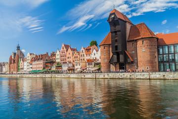 GDANSK, POLAND - SEPTEMBER 2, 2016: Riverside houses by Motlawa river in Gdansk, Poland. Medieval crane in the background.