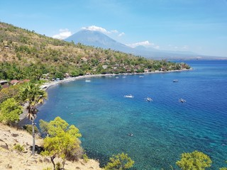 City of Amed with Mount Agung in the background - Bali