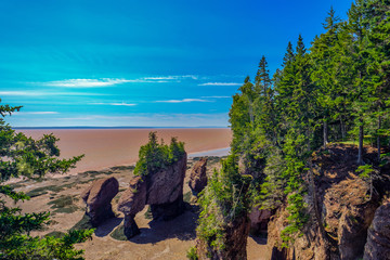 Horizontal image of The ay of Fundy and the flowerpots rocks normally under forty feet of water and the chocolate waters of the bay of Fundy