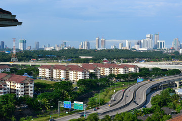High angle view of Johor Bahru's cityscape with highway and skyline in the afternoon