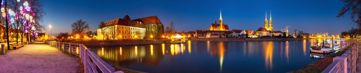 Cityscape, evening panorama - view on the embankment river Odra of the city Wroclaw and its old district Ostrow Tumski, Lower Silesia Province, The Poland