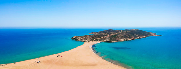 Aerial birds eye view drone photo Prasonisi on Rhodes island, Dodecanese, Greece. Panorama with nice lagoon, sand beach and clear blue water. Famous tourist destination in South Europe