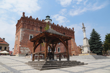Poland. Town hall and historic well in the main market of the city of Sandomierz.