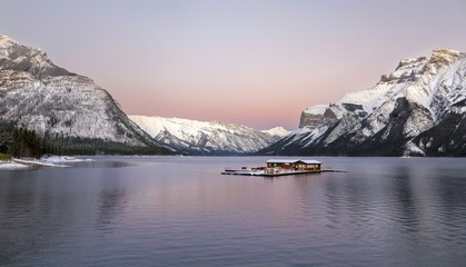 Dramatic Sunset Sky and Distant Snowcapped Rocky Mountains at Lake Minnewanka in Banff National Park, Alberta, Canada