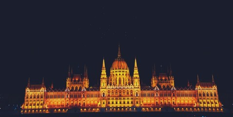 Budapest city at night with illuminated Budapest Hungarian parliament near Danube River, picturesque evening cityscape. Night view of illuminated Budapest.