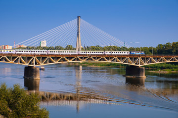 Warsaw, Poland - Panoramic view of the Vistula river with Most Srednicowy railway bridge and northern district of Warsaw