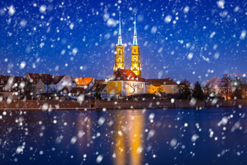 Old town of Wroclaw on a cold winter night with falling snow, Poland