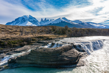 Waterfall and granite towers at Torres del Paine national park of Chile