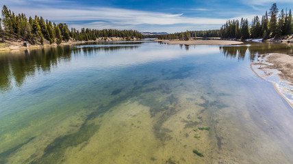 A view from the Fishing Bridge spanning the Yellowstone river in Yellowstone National Park, USA