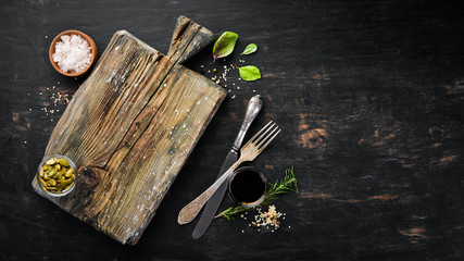 Kitchen wooden board. Food Background. On a wooden background. Top view. Free space for your text.