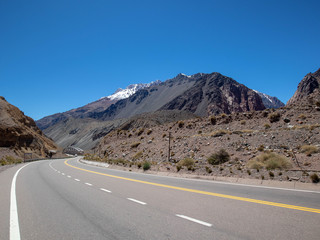 Andes mountaines together with the road in Mendoza, Argentina