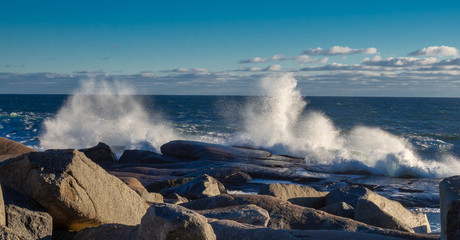 Winter waves at Peggy's Cove in Nova Scotia during sunset, peaceful, waves, powerful.