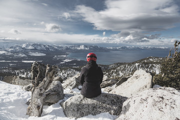 Snowboarder Sitting Enjoying a Heavenly View of Lake Tahoe