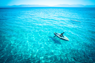 View from Lake Tahoe with tropical blue color water and canoe