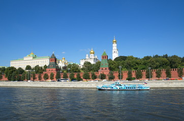 Beautiful summer view of the Moscow Kremlin and sailing pleasure boat, Russia