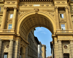 Arcone Triumphal Arch at the Republic Square in Florence, Italy. The Arch was built in 1895. Old city. Tourist attractions. Italian architecture. Landmarks of Italy.