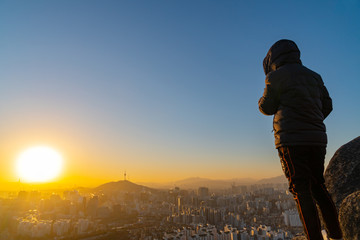 Young man traveler looking at Seoul city ,South Korea