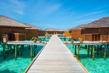Wooden walkway to resort in Maldive.
