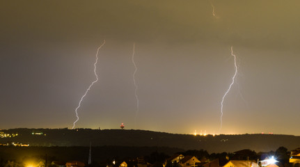 Lightning strikes during thunderstorm over the city