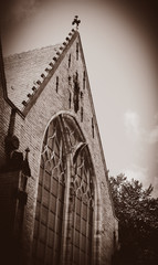View at facade of old church in Amsterdam, Netherlands . Image in sepia color style