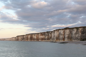 the white alabaster cliff coast with high tide in normandy, france