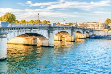 Old stone bridge across Seine river in Paris