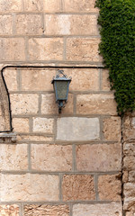 lantern on the stone wall of the building