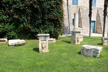 Historic stone monuments in park in Sibenik, Croatia.