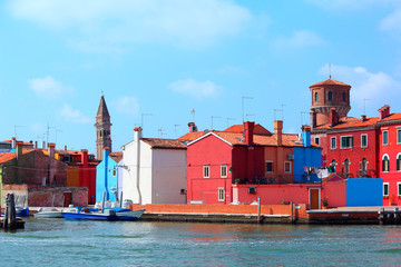 colored houses and old bell tower in the island of Burano near Venice in Italy