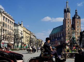 Krakow, Poland - April, 2010: Main Market Square (Rynek Glowny) and Mariacki Church, of Old Town of Krakow